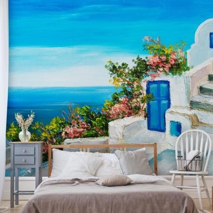 Σπίτι κοντά στη θάλασσα με πολύχρωμα λουλούδια.