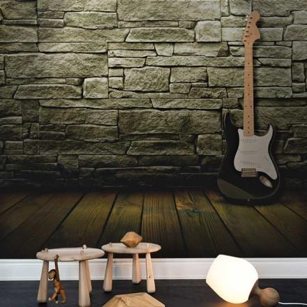 Ηλεκτρική κιθάρα σε πέτρινο φόντο